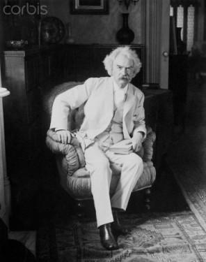 Mark Twain Sitting in Armchair